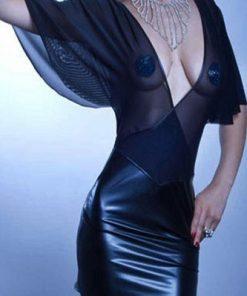 Genomskinlig Klänning svart  med mesh tyg och avslutar med en läderkjol.